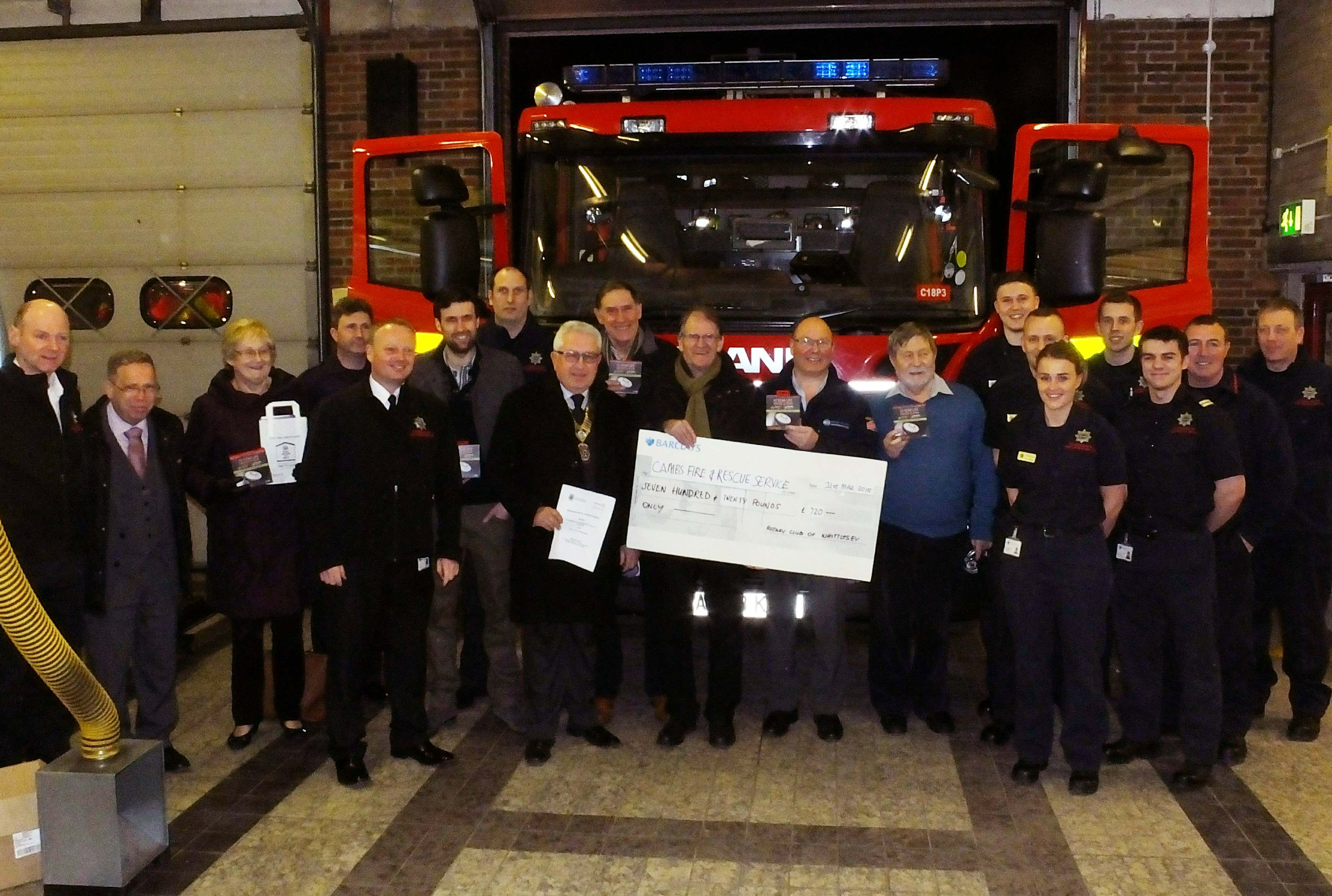 Firefighters standing with Whittlesey Rotary Club